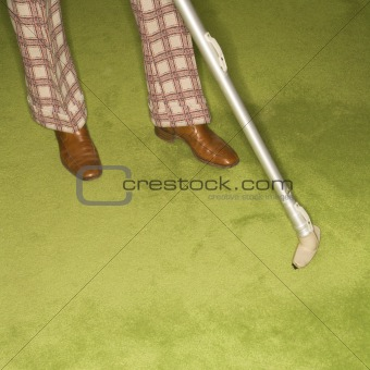 Man vacuuming rug.